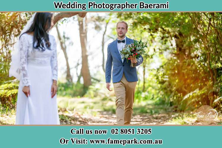 Photo of the Groom bringing flower to the Bride Baerami NSW 2333