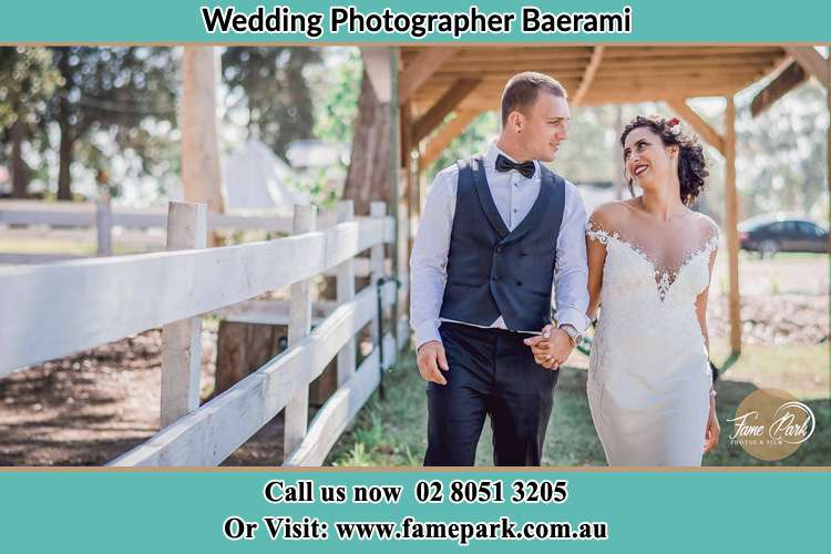 Photo of the Groom and the Bride holding hands while walking Baerami NSW 2333