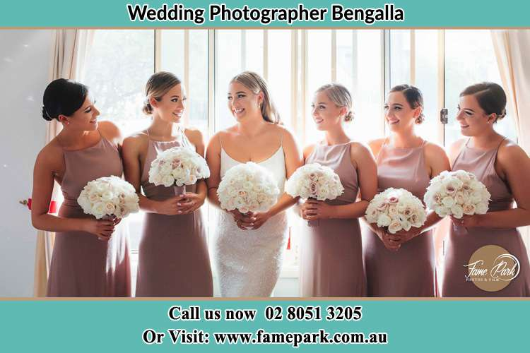 Photo of the Bride and the bridesmaids holding flower bouquet Bengalla NSW 2333