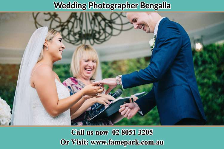 Photo of the Bride wearing ring to the Groom Bengalla NSW 2333