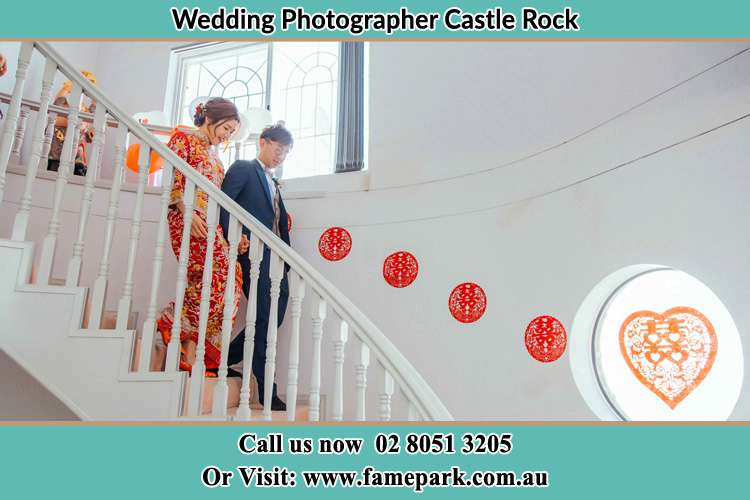 Photo of the Bride and the Groom going down the stair Castle Rock NSW 2333