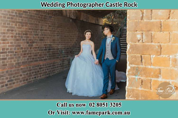 Photo of the Bride and the Groom walking Castle Rock NSW 2333