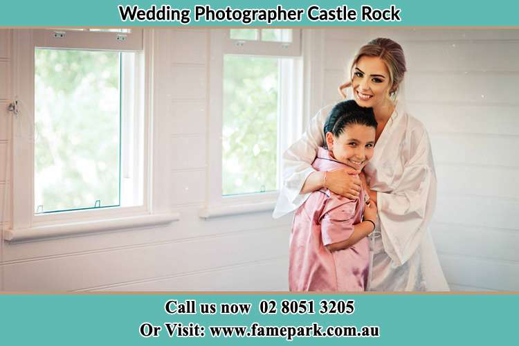 Photo of the Bride hugging the flower girl Castle Rock NSW 2333