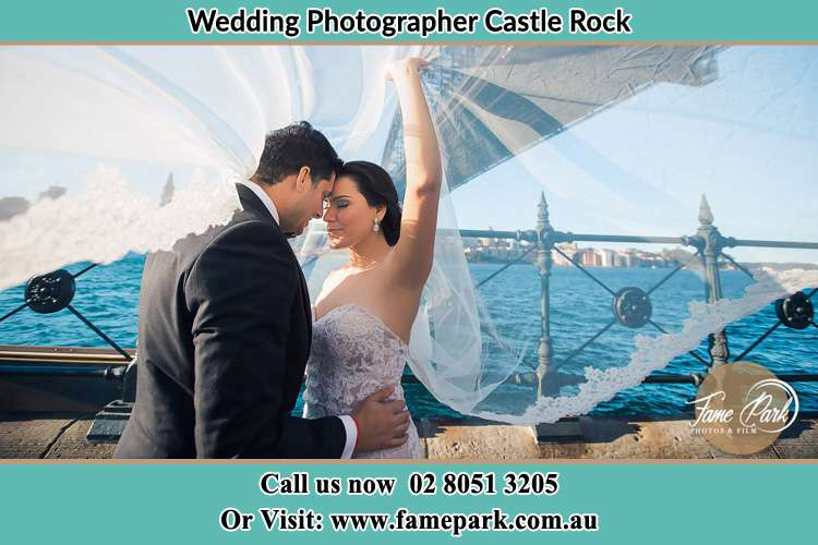 Photo of the Groom and the Bride kissing Castle Rock NSW 2333