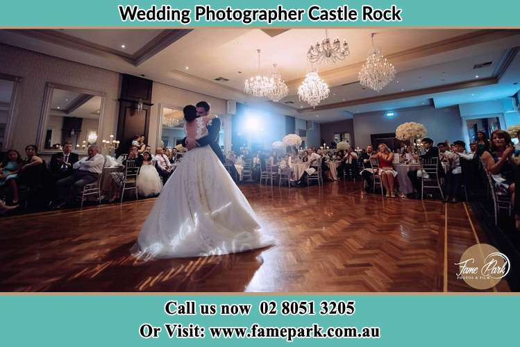 Photo of the Bride and the Groom hugging on the dance floor Castle Rock NSW 2333