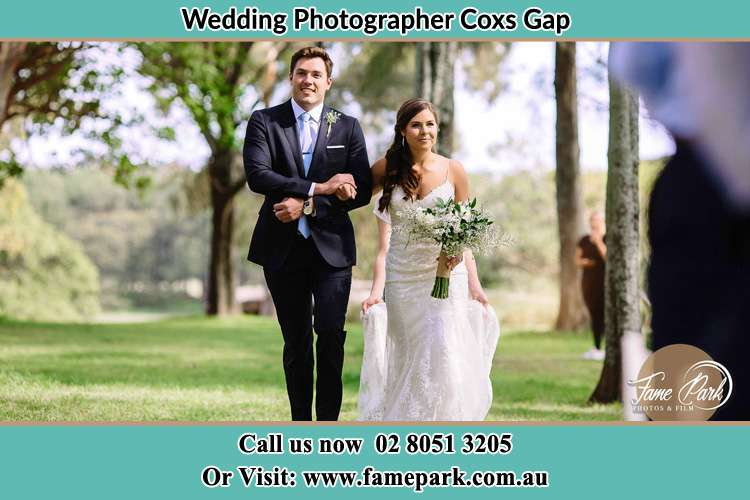 Photo of the Groom and the Bride walking Coxs Gap NSW 2333