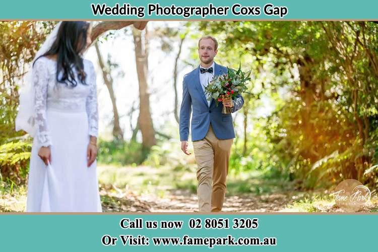 Photo of the Groom bringing flower to the Bride Coxs Gap NSW 2333