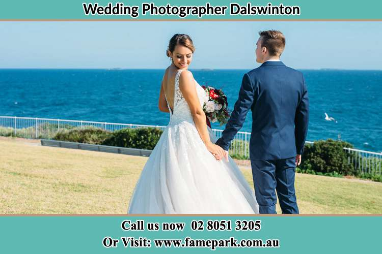 Photo of the Bride and the Groom holding hands at the yard Dalswinton NSW 2328