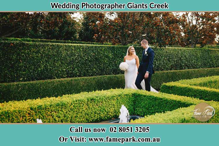 Photo of the Bride and the Groom walking at the garden Giants Creek NSW 2328