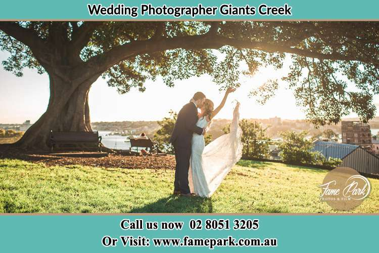 Photo of the Bride and the Groom kissing under the tree Giants Creek NSW 2328