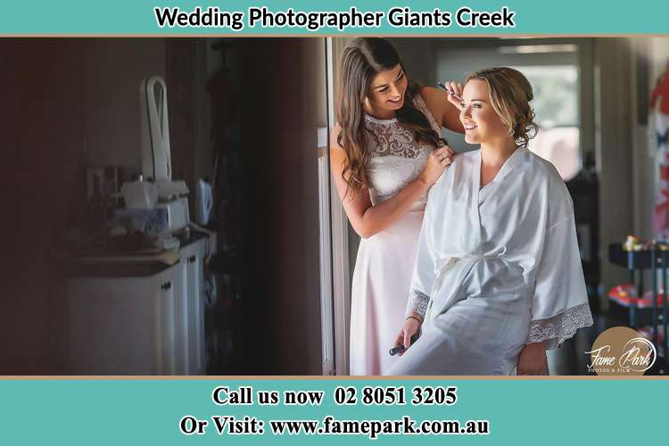Photo of the Bride having make up Giants Creek NSW 2328