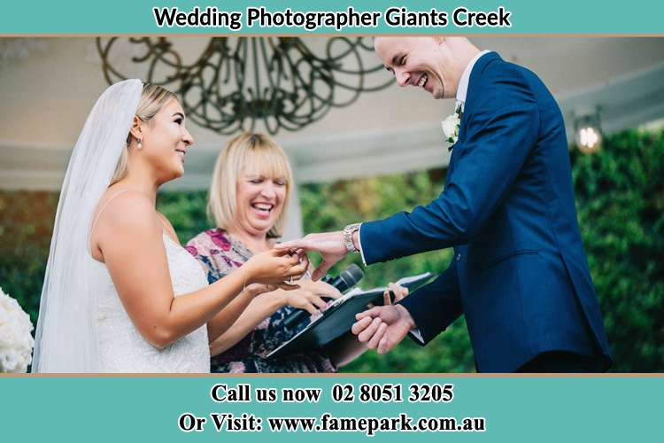 Photo of the Bride wearing ring to the Groom Giants Creek NSW 2328