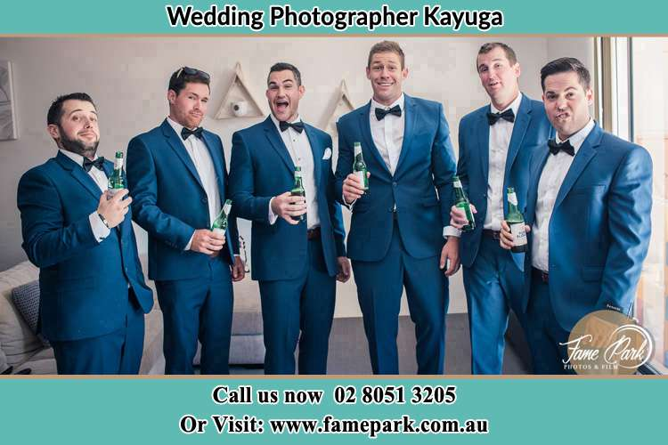 The groom and his groomsmen striking a wacky pose in front of the camera Kayuga NSW 2333