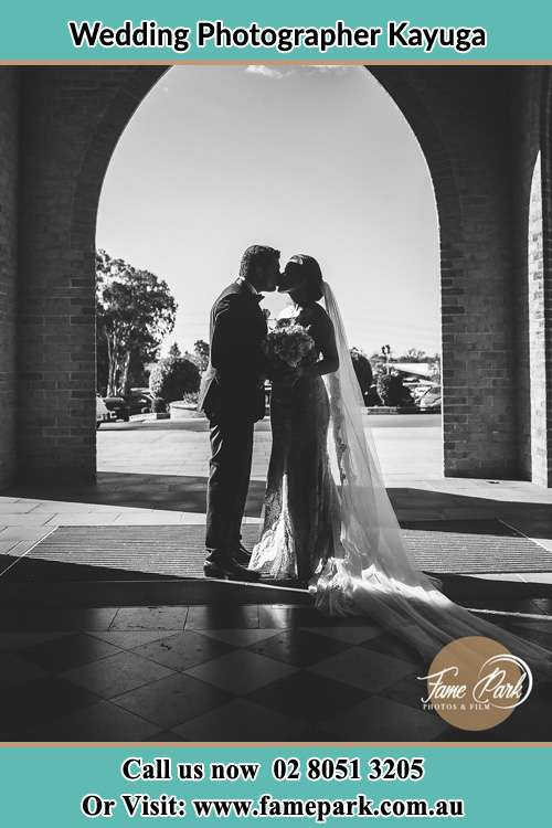 Photo of the Groom and the Bride kissing Kayuga NSW 2333