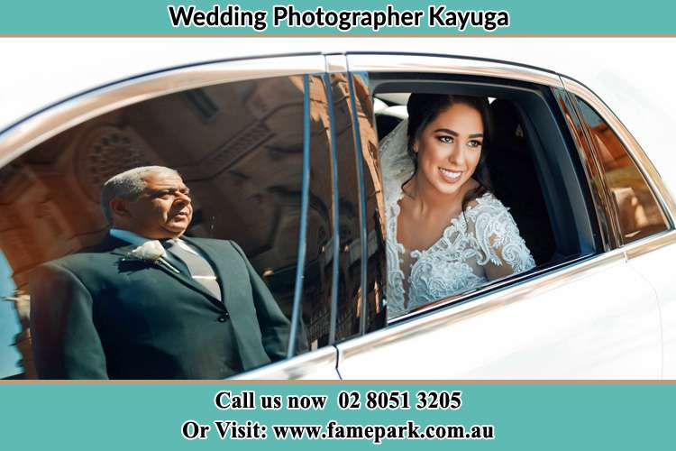 Photo of the Bride inside the bridal car with her father standing outside Kayuga NSW 2333