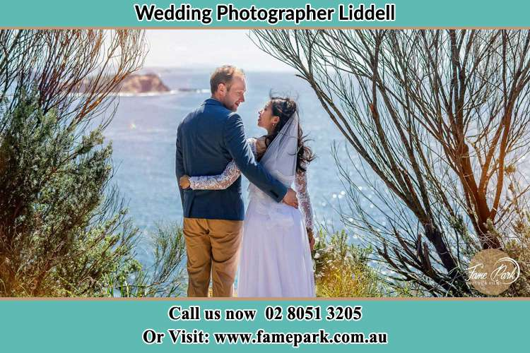 Photo of the Groom and the Bride looking each other near the sea front Liddell NSW 2333