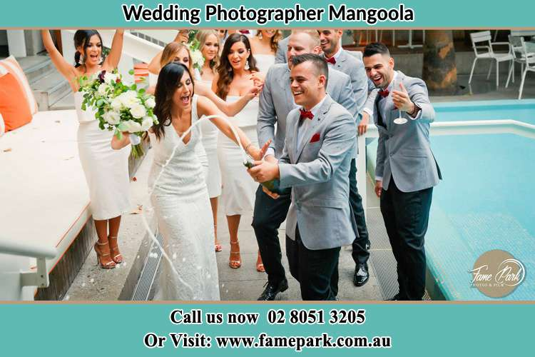 Photo of the Groom and the Bride celebrating with the secondary sponsors Mangoola NSW 2333