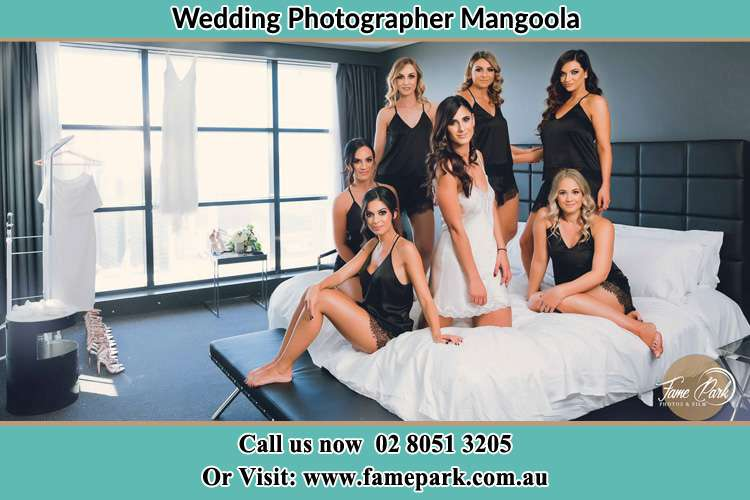 Photo of the Bride and the bridesmaids wearing lingerie on bed Mangoola NSW 2333