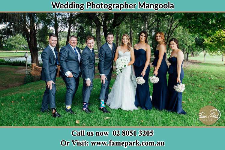 The Bride and the Groom with their entourage pose for the camera Mangoola NSW 2333