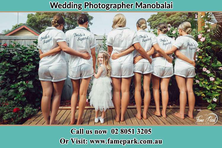 Behind photo of the Bride and the bridesmaids with the flower girl looking back Manobalai NSW 2333