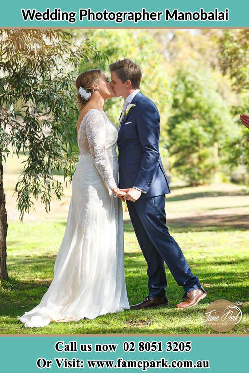 Photo of the Bride and the Groom kissing at the garden Manobalai NSW 2333