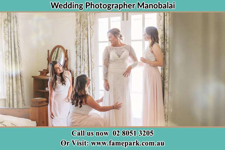 Photo of the Bride and the secondary sponsor preparing Manobalai NSW 2333