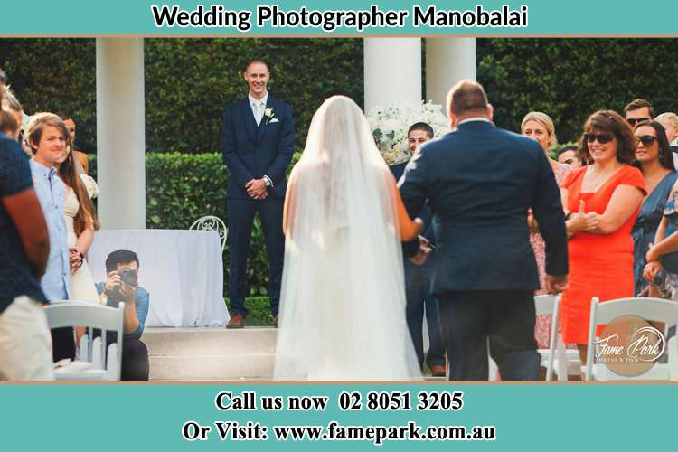 Photo of the Bride with her father walking the aisle Manobalai NSW 2333