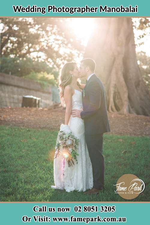 Photo of the Bride and the Groom kissing at the yard Manobalai NSW 2333