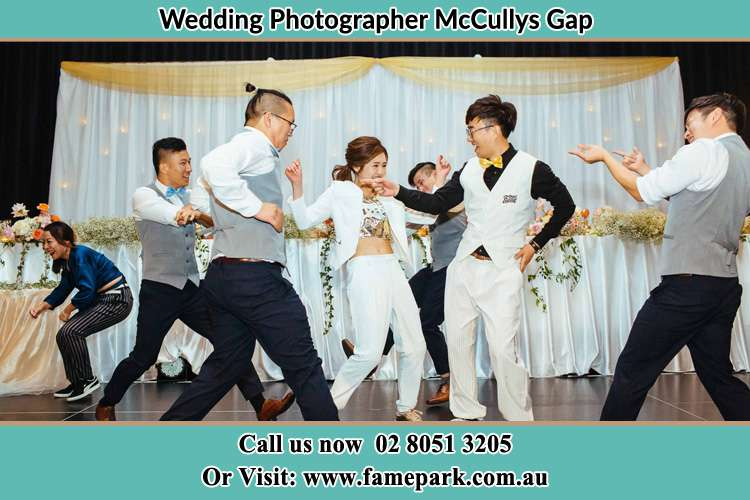 Photo of the Groom and the Bride dancing with the groomsmen McCullys Gap NSW 2333