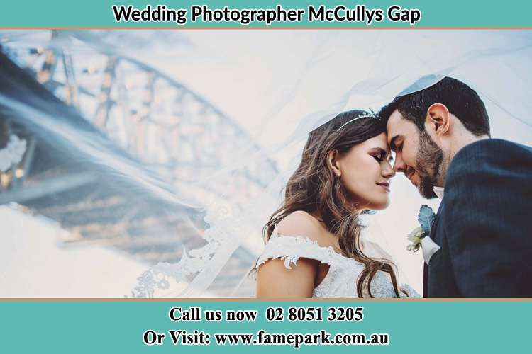 Close up photo of the Bride and the Groom under the bridge McCullys Gap NSW 2333