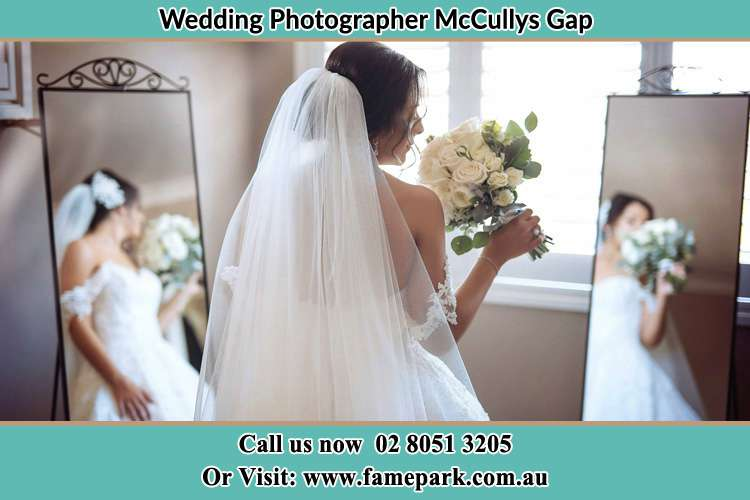 Photo of the Bride holding flower at the front of the mirrors McCullys Gap NSW 2333