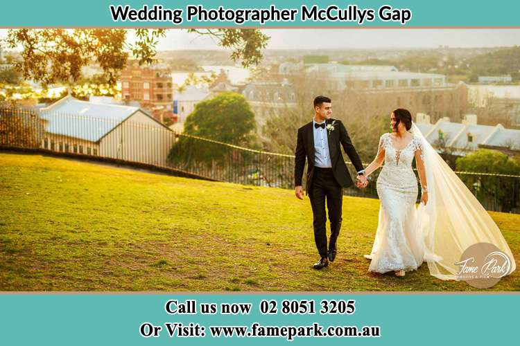 Photo of the Groom and the Bride walking at the yard McCullys Gap NSW 2333