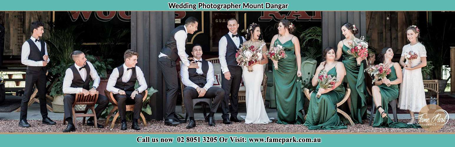The Bride and the Groom with their entourage pose for the camera Mount Dangar NSW 2333