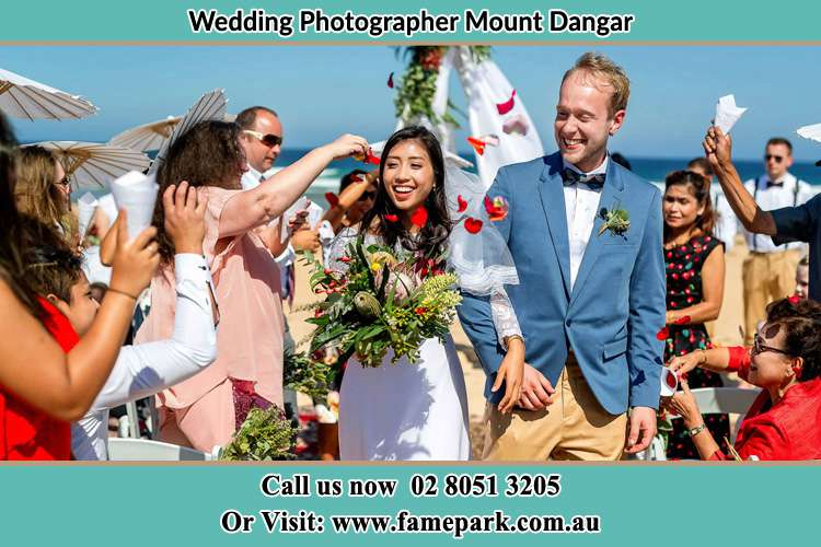 Photo of the Bride and the Groom showering flower petal by the visitors Mount Dangar NSW 2333