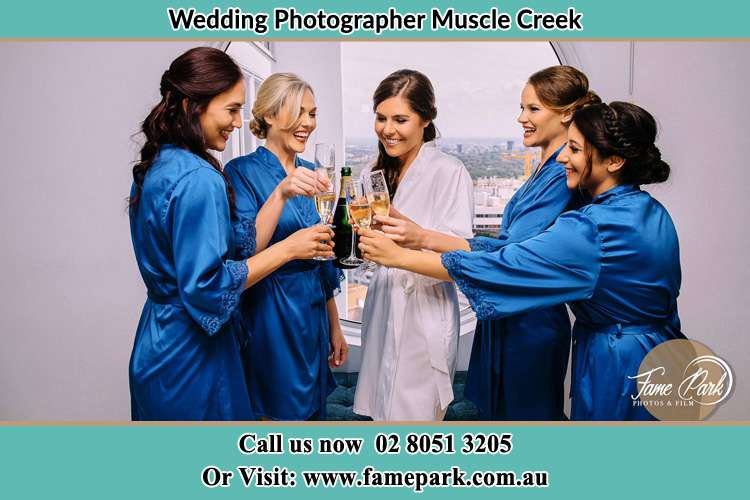 Photo of the Bride and the bridesmaids having wine Muscle Creek NSW 2333