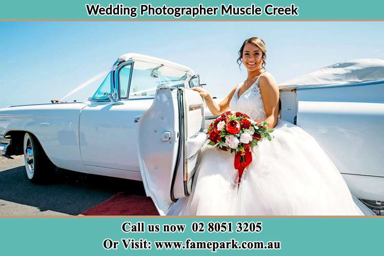 Photo of the Bride outside the bridal car Muscle Creek NSW 2333