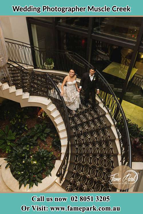 Photo of the Bride and the Groom going down the stair Muscle Creek NSW 2333