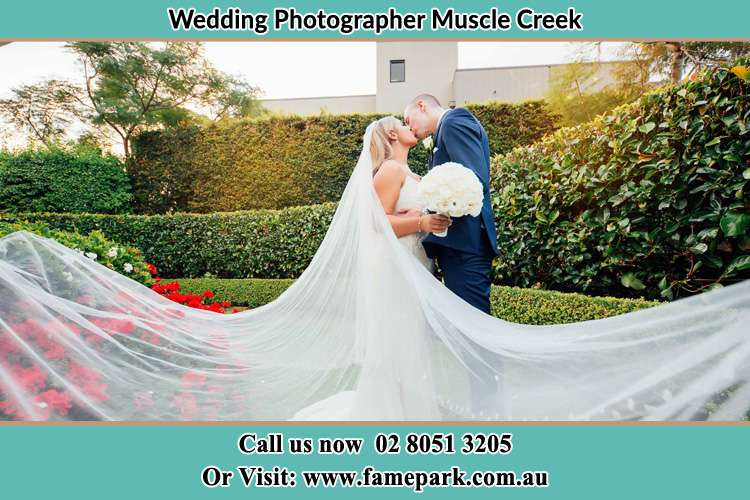 Photo of the Bride and the Groom kissing at the garden Muscle Creek NSW 2333