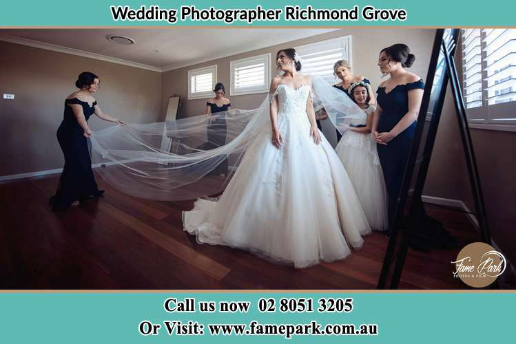 Photo of the Bride and the secondary sponsor preparing Richmond Grove Rd NSW 2333