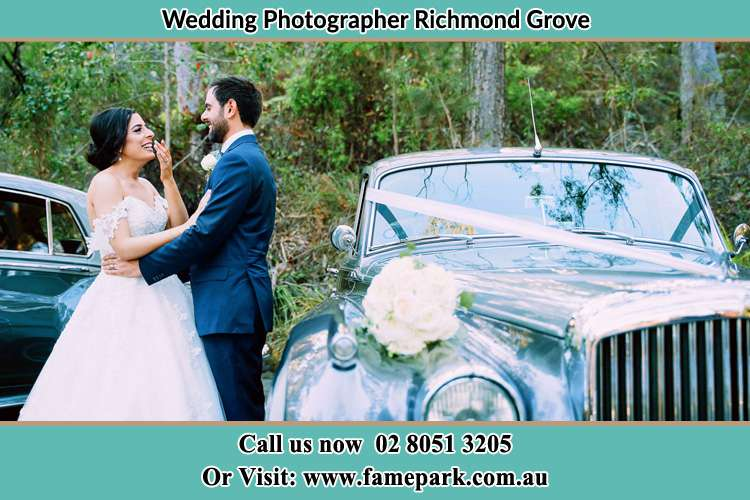 Photo of the Bride and the Groom near the bridal car Richmond Grove Rd NSW 2333