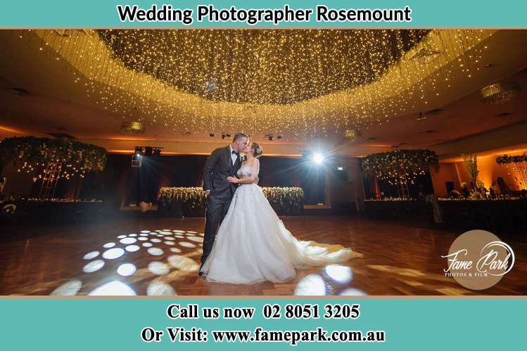 Photo of the Groom and the Bride kissing on the dance floor Rosemount NSW 2328