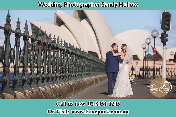 The Groom and the Bride walking towards the Sydney Grand Opera House Sandy Hollow NSW 2333
