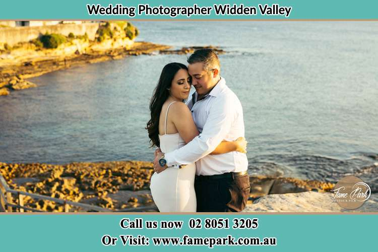 Photo of the Bride and the Groom hugging near the lake Widden Valley NSW 2328