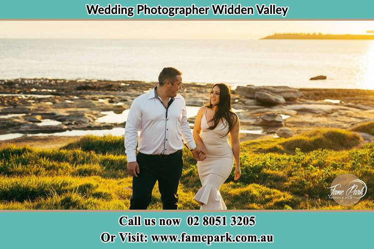 Photo of the Groom and the Bride walking near the lake Widden Valley NSW 2328